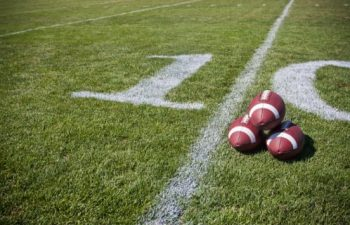 Football Field with 3 Footballs