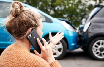 Woman on Phone After Car Wreck