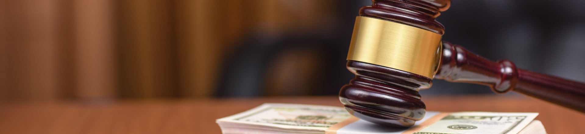 Judges Gavel And Bundles Of Money On The Judges Table, Inadequate Building / Apartment Security Claims Lawyer