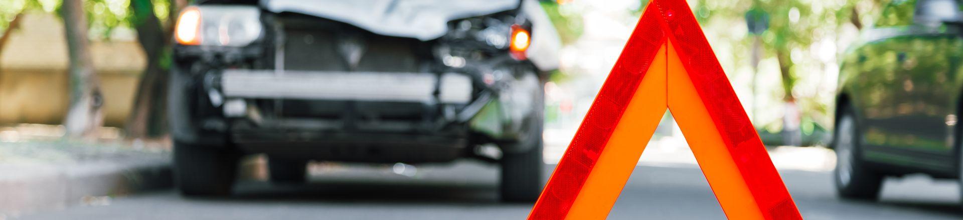 Broken gray Car During Road Traffic Accident
