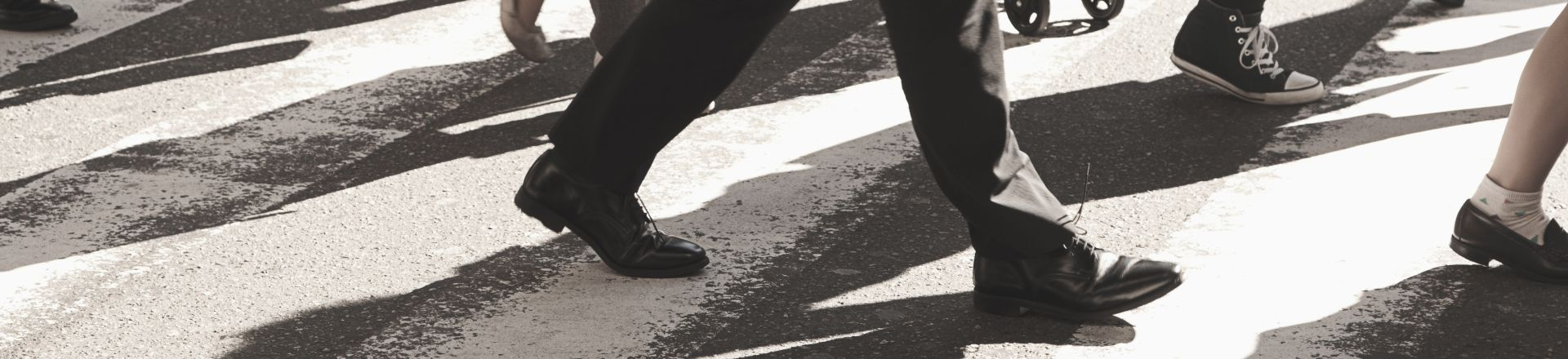 People Crossing The Road At A Pedestrian Crossing. Pedestrian Accidents Injury Lawyer