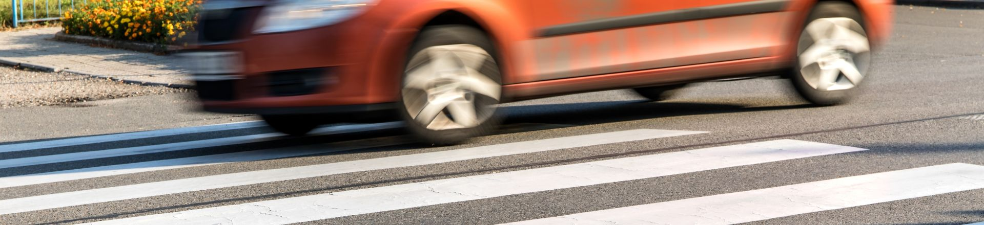 Orange Cars On The Pedestrian Crossing. Pedestrian Accidents Injury Lawyer