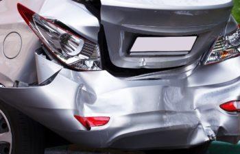 A car has a big dent after an accident