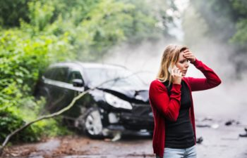 Young Woman On the Phone After a Car Crash